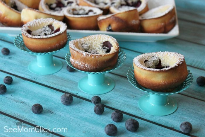 My family gobbled up these blueberry dutch baby pancake which I made in a muffin tin for easy serving, in a snap. They're delicious and SO easy! A perfect breakfast recipe or easy brunch recipe.
