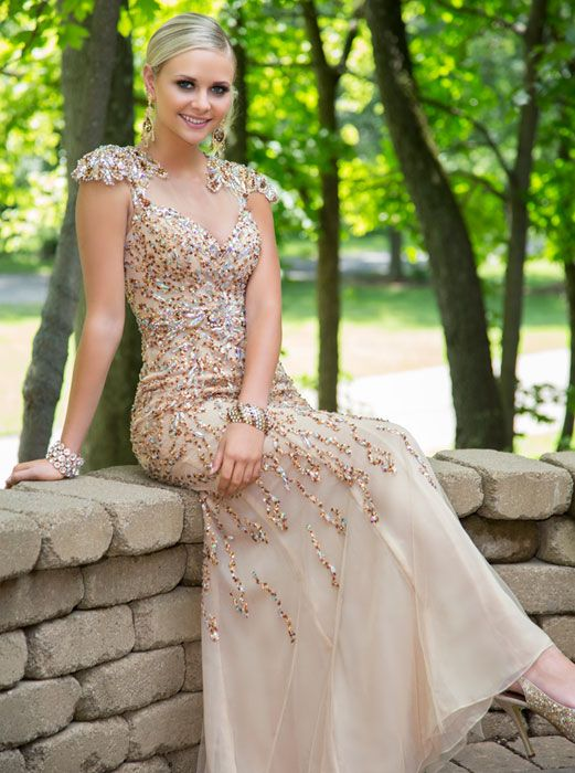 59-1 Cool Collection by Jovani Everyone will stop and stare when you step out in this wonderfully unique and beautiful Cool Collection by Jovani dress. This lavish look will have you posing for photographs all night long as if the paparazzi were covering the prom! Regal, elegant, and sophisticated, this gown will make you look and feel like a movie star.