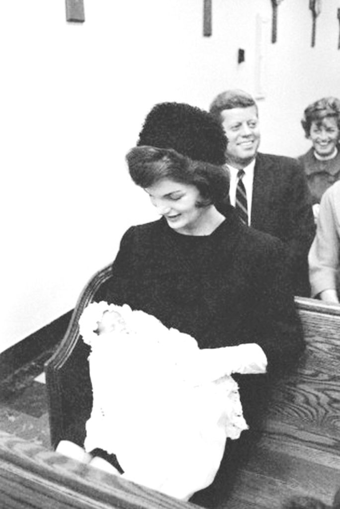 John Fitzgerald Kennedy, Jr., makes his first public appearance in the arms of his beaming mother, Jacqueline, as President-elect Kennedy smiles proudly in the background. John Jr,. born early November 25th, wears his father's 43-year-old baptismal gown, in which he was christened and photographed for the first time at the Georgetown University Hospital Chapel in Washington.❤❤❤ ❤❤❤❤❤❤❤ http://en.wikipedia.org/wiki/John_F._Kennedy http://en.wikipedia.org/wiki/Jacqueline_Kennedy_Onassis