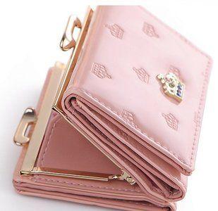 Trendy roze portemonnee  Diverse Compartimentenvoormunten,papiergeld,foto en kaartjes. Gemaakt vanhoge kwaliteitkunstleer.  Afmeting 15cmLx9cmH x 3cm B kleur roze...