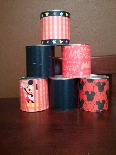 """""""Mickey Mouse Can Toss Game"""" I covered infant formula cans with scrapbook paper using Modge Podge."""
