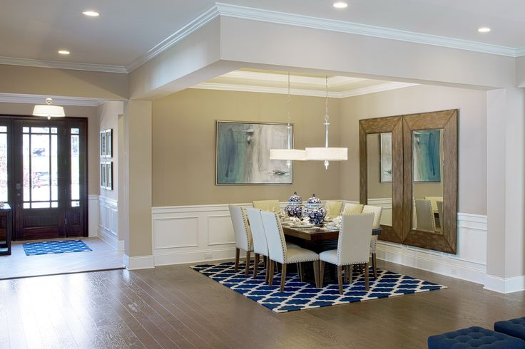Blue hues are trending in a big way – especially in new homes that feature a nautical or coastal flair. Our newest Show Home episode focuses on a model home where shades of blue are dominant – and a Cape Cod influence is infused  to offer a striking, yet livable, space. Status chandeliers featured.