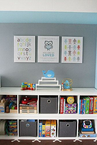 Kid-Level Storage: When she was making over her toddlers bedroom, POPSUGAR community member Mrs. Piecemaker flipped two skinny Expedit shelves on their sides, and stacked them, resulting in a storage space thats just the right height for her little man.  She incorporated gray drawers that complement the rest of the rooms color palette, and utilized the top of the shelves for additional accessible storage space. Source: POPSUGAR Moms community member MrsPiecemaker