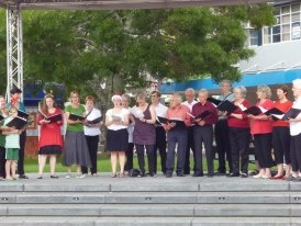 Civic Choir singing in Garden Place
