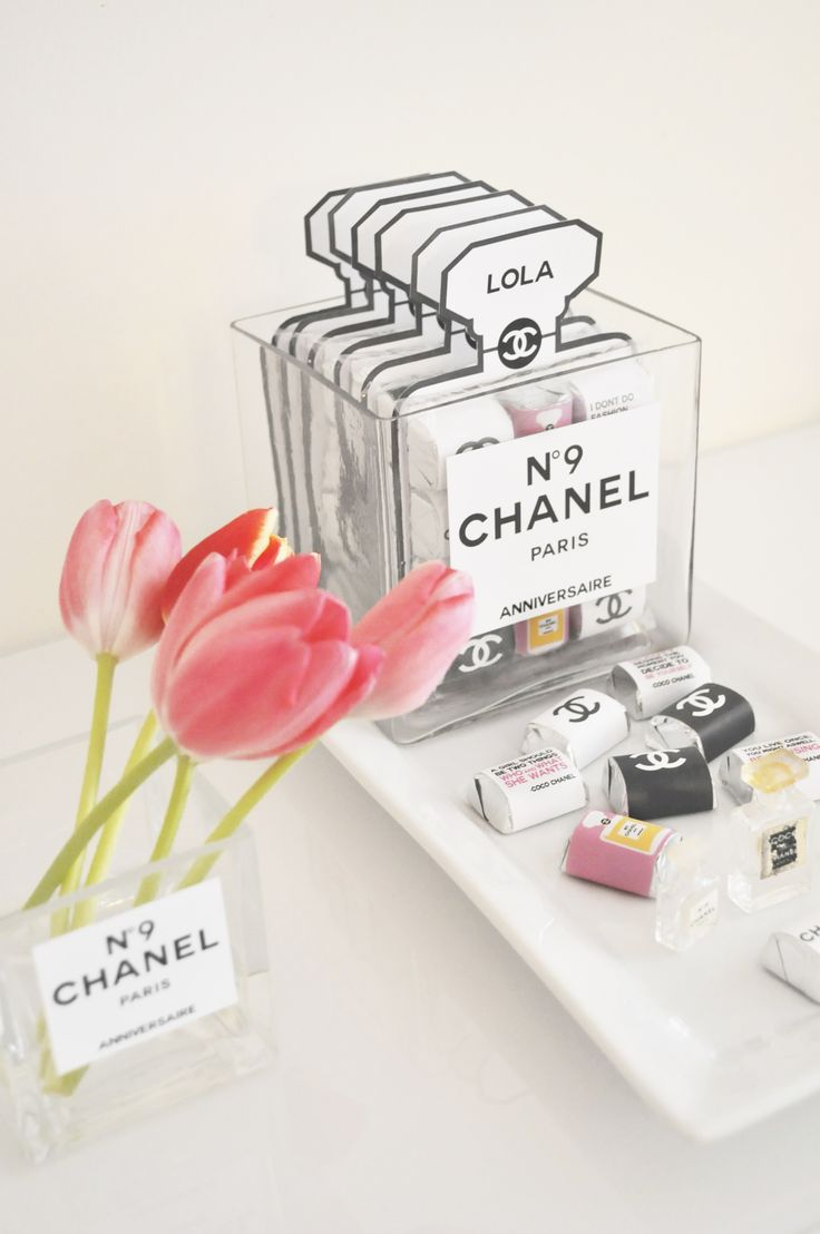 Love the Coco Chanel party favors. HERSHEY'S Nuggets Wraps. Lovely inside the Chanel perfume label vase.