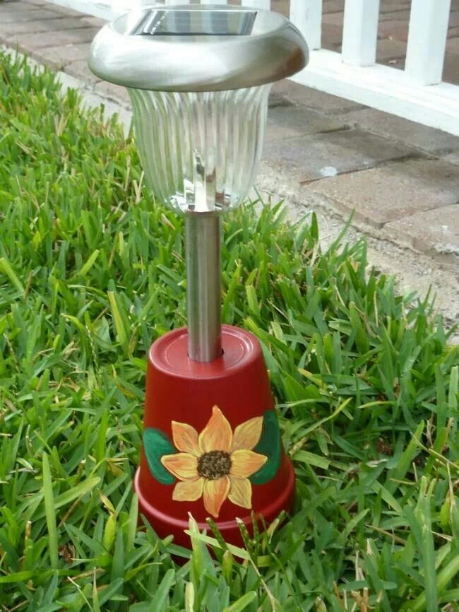 Painted upside down pot makes a great movable solar light holder for yard or deck!