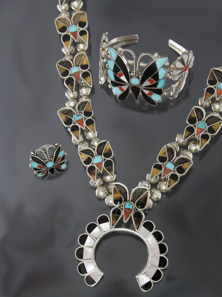 "<p><span style=""font-size: 13.6px;"">Wallace Butterfly Zuni Jewelry Set. Squash blossom style necklace with bracelet and ring, turquoise, coral and jet in sterling silver. Necklace measures 26 inches long, the naja is 2 3/4 long by 2 1/8 inches wide. The b"