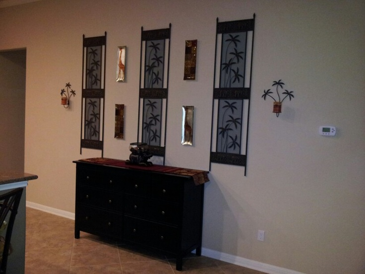 detach a screen divider and hang decorative plates to fill a large wall space