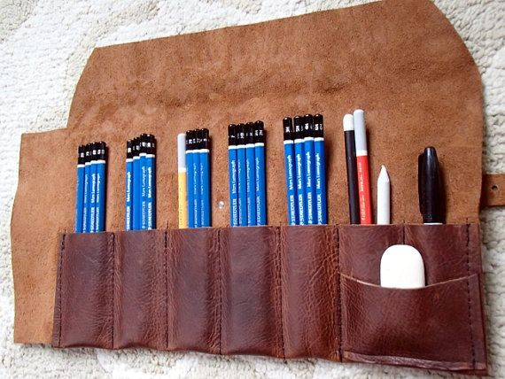 Store your drawing and painting tools in a Leather Pencil Roll. Made from high quality, durable, incredibly soft, oil tanned Kodiak leather that is constructed to conveniently store and transport your art supplies. Open, the dimensions are 10 1/2 x 15. It has a stainless steel roller buckle and diamond shaped rivet on an adjustable 3/4 strap to hold the roll closed. The seven slots can accommodate short and medium handled paintbrushes, pencils, markers, colored pencils and any other...