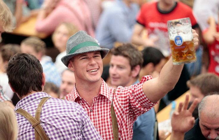 A young man raises a beer mug at the Hofbräuhaus beer tent during day 1 of Oktoberfest 2013, on September 21, 2013. (Credit: Johannes Simon/Getty)