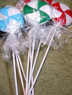 I have had the idea in my head of making my house look like a giant Gingerbread house for quite awhile. I am finally going to start making that happen! I made some cute Christmas candy lollipops for the front yard for super cheap.