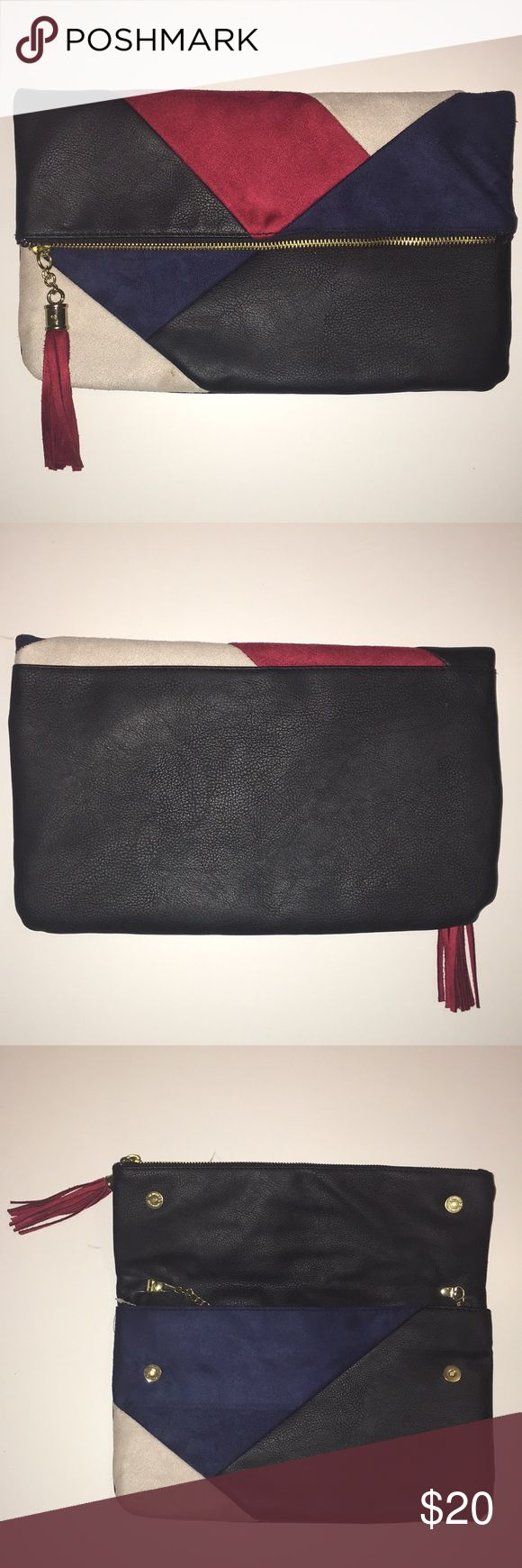 Crossbody purse/clutch Red, Black, Navy Blue, and White clutch that doubles as a crossbody purse. Has a lot of space for storing items. Black parts are faux leather. Red, Navy Blue, and White areas are faux suede. Red tassel adds super cute detailing. Bags Shoulder Bags