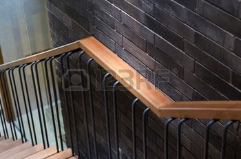 wooden handrail: Wooden handrail with brick wall background