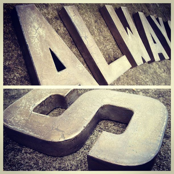 Faux Metal Letters Using cheap wooden letters at Hobby Lobby $2.47 each, spray paint with crackle paint and layer over with metallic!