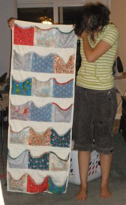 colorful hanging fabric organizer... like a shoe holder, but for other baby stuff.
