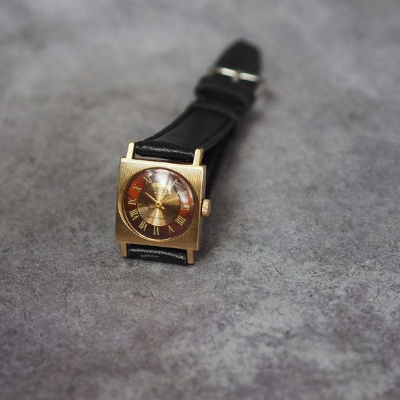 Vintage soviet womens bracelet watch Cornavin, made in USSR (1970s), gold plated case  The watch is in very good working order, runs and keeps correct time case: 23x30mm   17 Jewels, mechanical movement, manual winding.