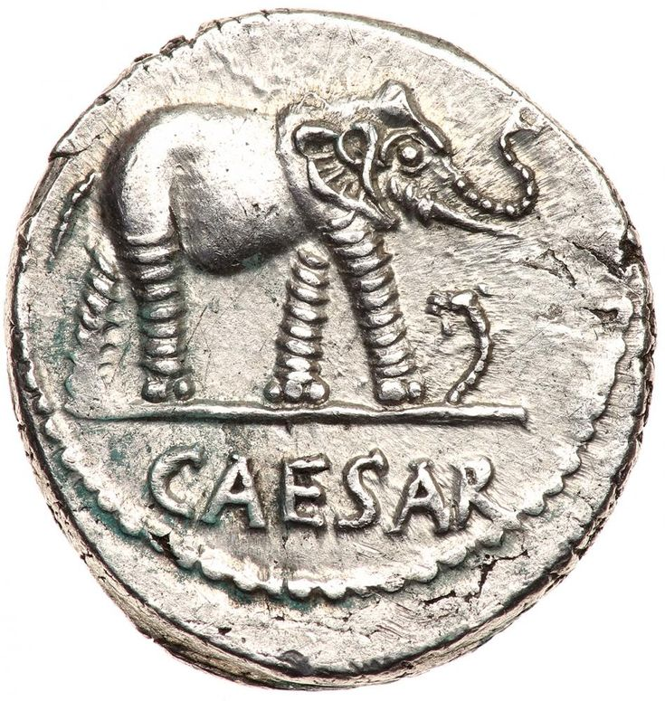 Julius Caesar. Silver Denarius (3.82 g), 49-48 BC EF Military mint traveling with Caesar. CAESAR in exergue, elephant advancing right, trampling horned serpent. Pontifical implements: simpulum, sprinkler, axe and priest's hat. Crawford 443/1; HCRI 9; Sydenham 1006; RSC 49. Perhaps the most ubiquitous of Caesar's denarii, this famous issue was struck at the time of his crossing of the Rubicon and the beginning of the long period of civil wars which resulted in the downfall of the Roman…