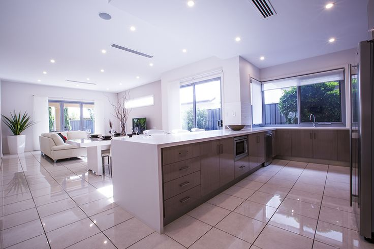 This stunning gourmet kitchen overlooks the large open plan dining and living area. #kitchen #home #weeksbuilding