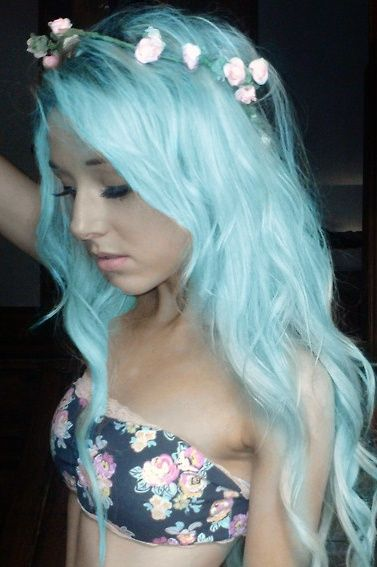 Pretty pastel blue hair with flower headband. I would never do this, but its pretty on her