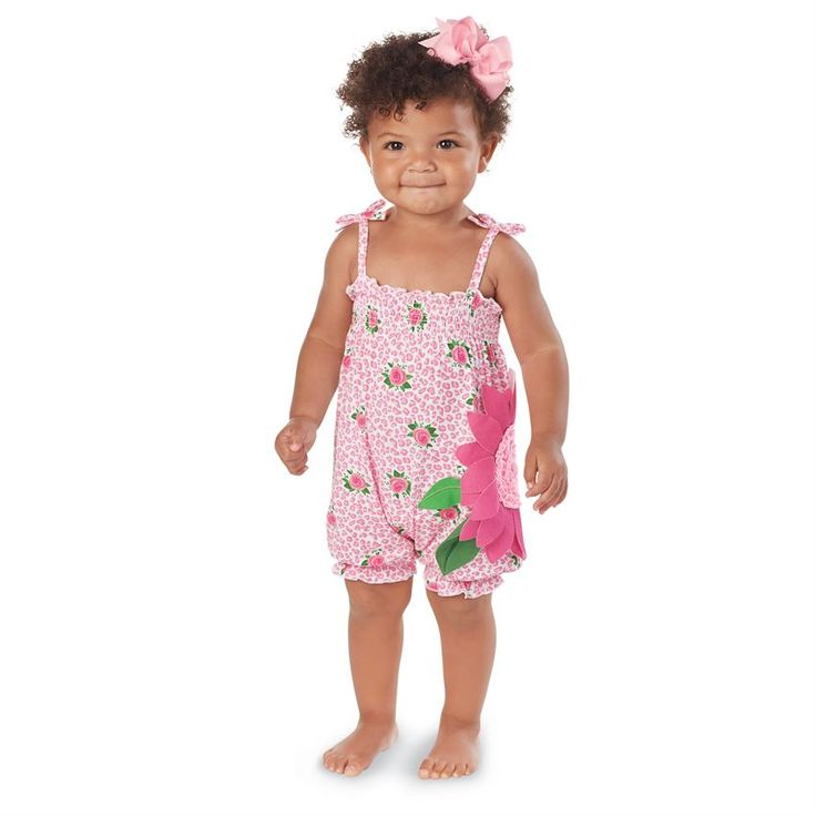 Soft rose-print bamboo-blend romper features bows at shoulder and dimensional flower applique with interlock petals, ruffled center and smocked neckline. Inner leg snap closure. #MudPieGift