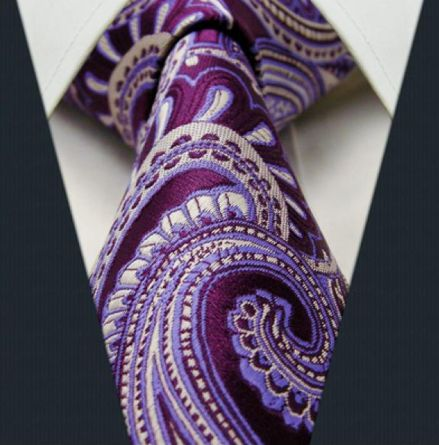 """Product number: PA-5761 Length: 57"""" Width: 3.5"""" Material: 100% Silk Care: Dry Clean Only Label: GENTLEMAN JOE This purple & silver, paisley tie will add a burst of class and elegance to your evening w"""