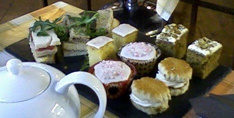 """Afternoon Tea: """"Traditional afternoon tea consists of a selection of dainty sandwiches (including of course thinly sliced cucumber sandwiches), scones served with clotted cream and preserves. Cakes and pastries are also served."""""""