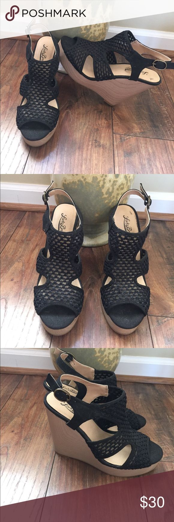 LUCKY BRAND WEDGES Only worn once on vacation!!! In brand new condition! Purchased at the lucky store! Very cute almost lace like  in black with light sand wedge. Heel is 4 inches with a 1 inch platform! Lucky Brand Shoes Wedges