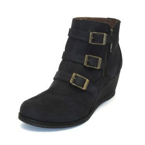 Gaimo - Nubuck Black Wedge Boot.  Add a bit of height to your look with this buckle trim wedge boot. Lovely nubuck upper leather, inner padded leather and rubber sole. Features round toe with an external zip and buckles for that perfect fit. 5cm wedge heel. Handmade in Spain.