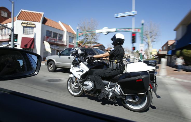 Garden Grove Police Department's Katherine Anderson patrols the city's downtown streets on her BMW. Photo by Christine Cotter