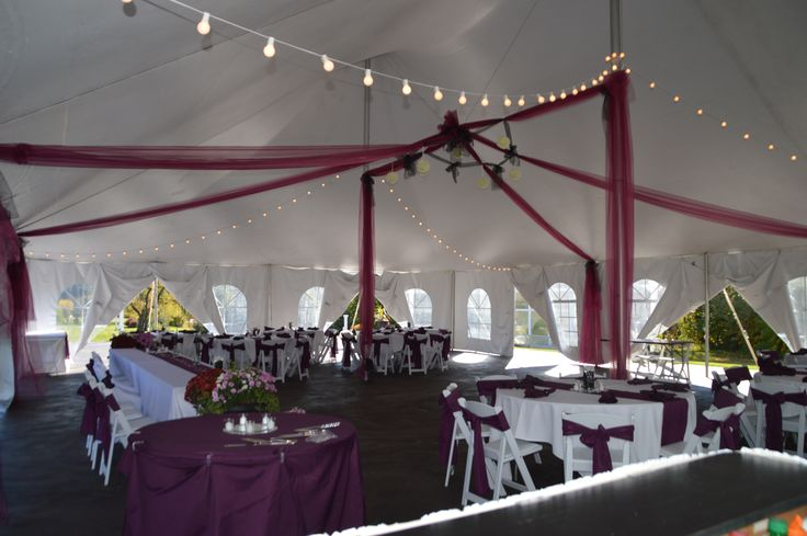 eggplant purple tent draping with ivory flower balls over the dance floor at Apple Blossom Chapel and Gardens
