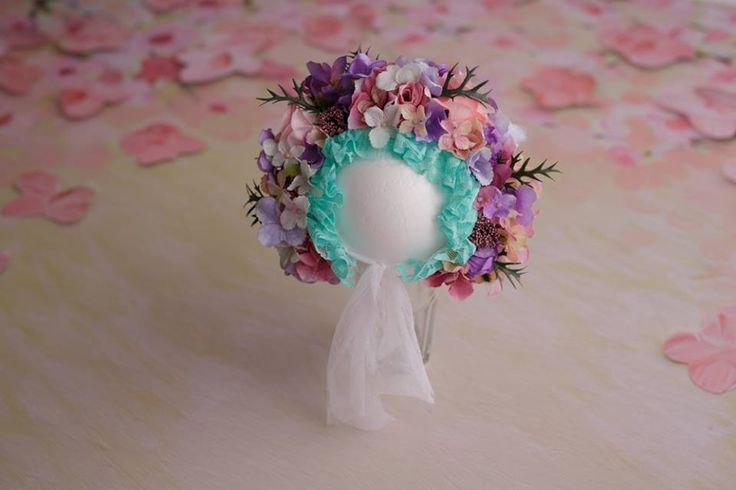 This bonnet is made on a flush base. This will suit children 6-12 months old.Made with fabric flower, high quality. Adjustable on the front, but also on the back.It's an RTS item.Ke...