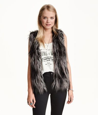 Faux fur vest in black and grey with side pockets. Hook-and-eye fastener at front. Lined.  | H&M Divided