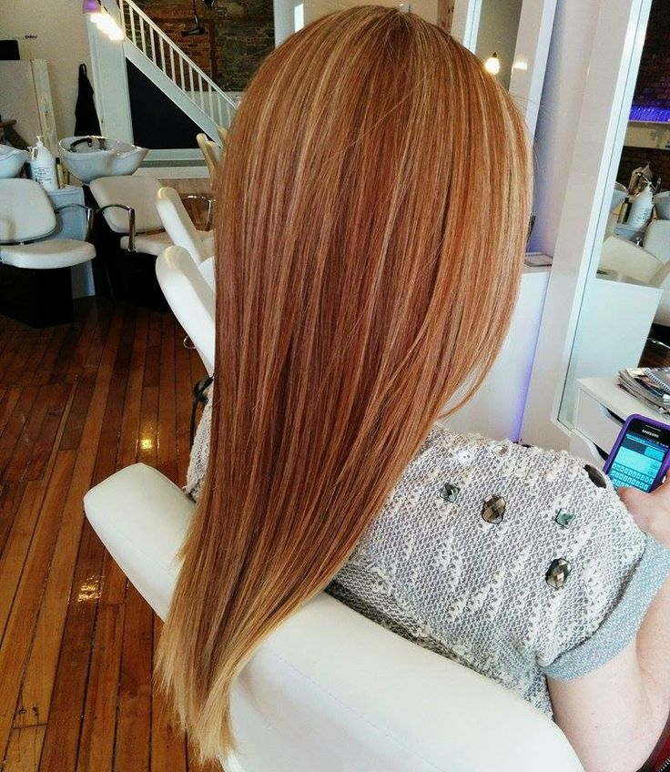 Highlighted natural redhead blown out with an ibiza roundbrush