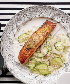 Seared Salmon With Israeli Couscous Salad recipe. Thinly sliced fennel, cucumber, and