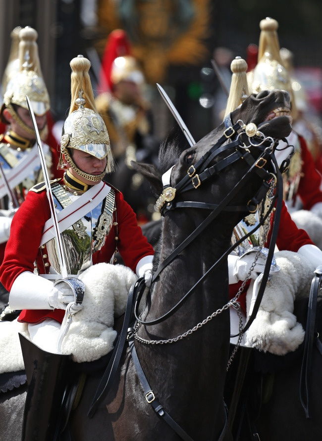 Household Cavalry ride outside Buckingham Palace during rehearsal for Trooping the Colour, 8 June 2013