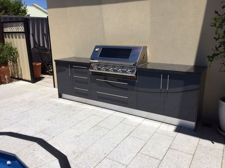 Outdoor Kitchen by the pool with Eleganz Perspex doors and granite benchtops