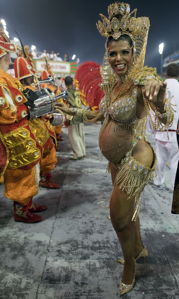 A pregnant dancer from the X-9 Paulistana samba school performs during a carnival parade in Sao Paulo, Brazil, early Saturday, Feb. 9, 2013