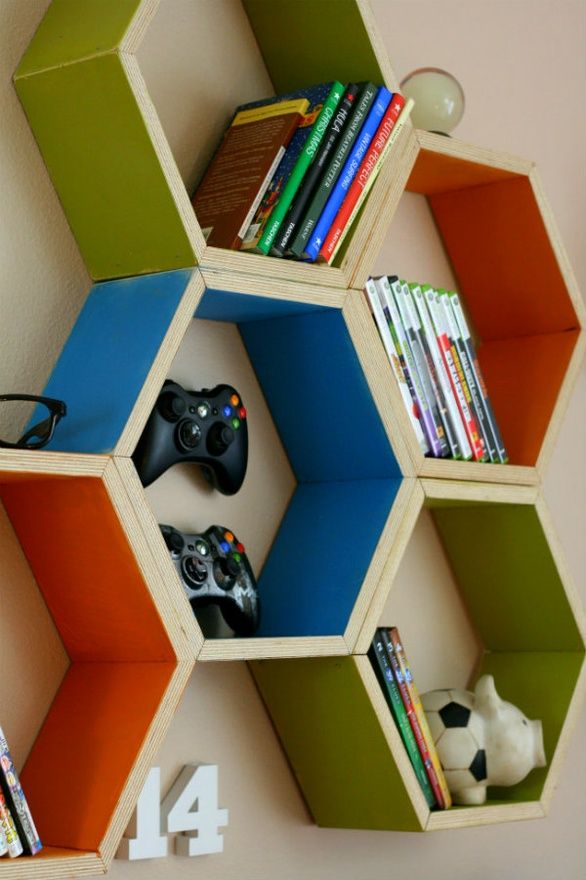 Wall storage in a fun design to keep the room kid-appropriate while making the most of wall space in small quarters.