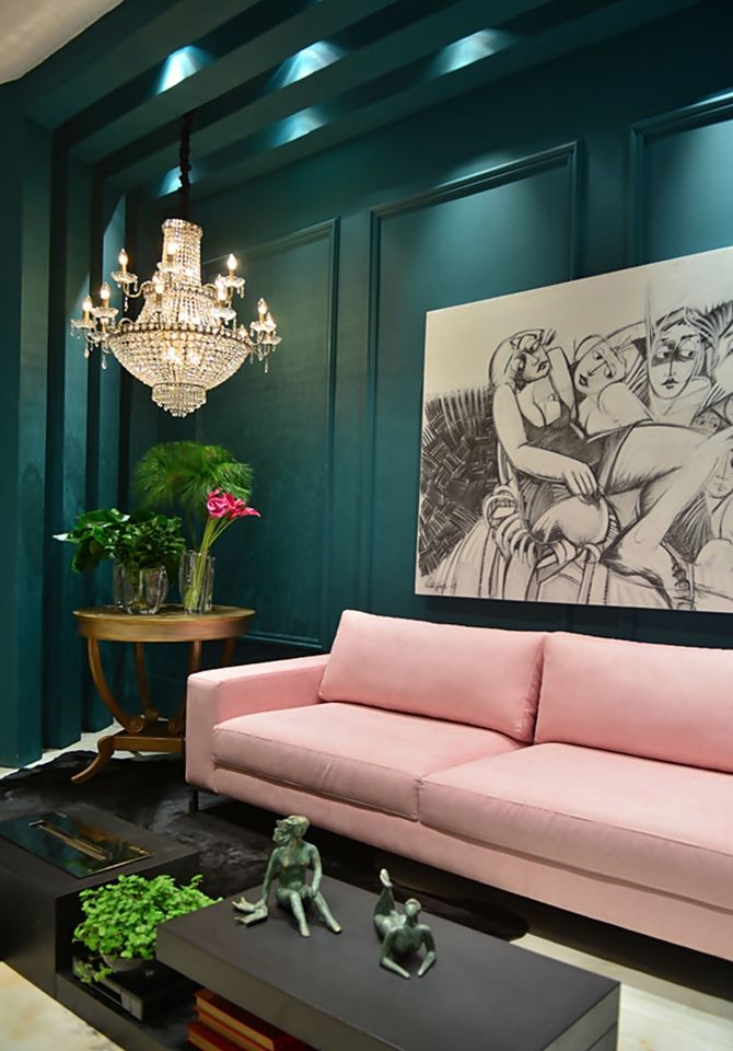 Beautiful Teal Painted Walls, Lovely Pink Sofa, Chandelier.  Love!