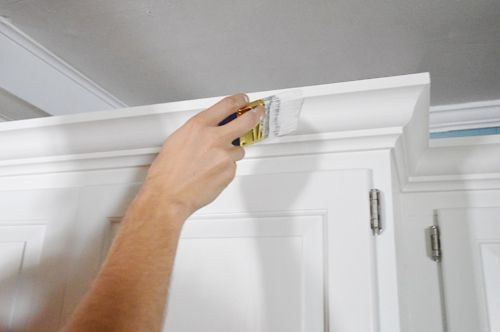 Young House Love | How To Add Crown Molding To The Top Of Your Cabinets | http://www.younghouselove.com