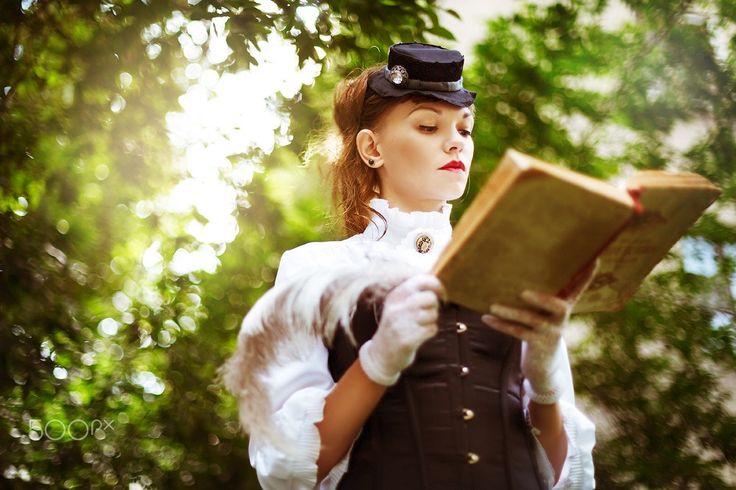 Vintage portrait of beautiful woman - Vintage portrait of beautiful woman reading book