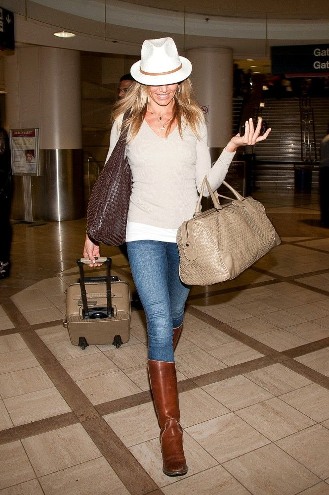 Jeans, brown boots and neutral top with a fedora. The perfect relaxed look - Cameron Diaz at LAX