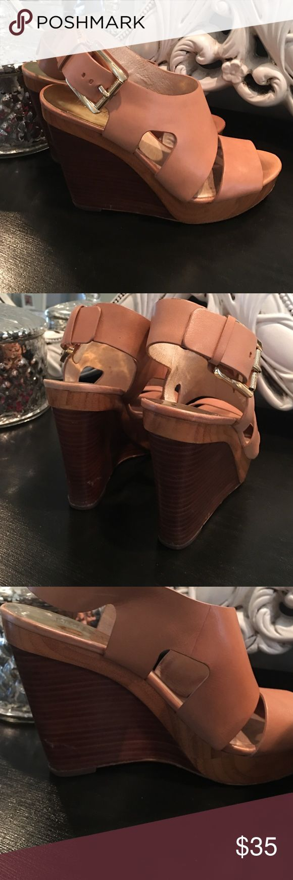 Michael Kors Tan Wedges Heels size 8 (wood trim) Gorgeous wood detail on the heel, excellent condition. Small blemish on inside left heel (cannot be seen when worn, could probably be shined out) Leather tan upper with wooden wedge. Michael Kors Shoes Wedges