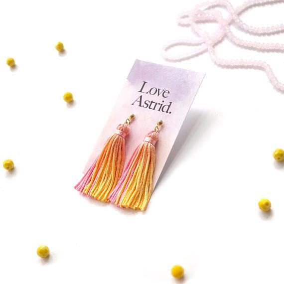 Meet Tierra (means Earth in Spanish), Love Astrids unique one-off earrings.  I always try to find ways to reduce waste, especially for Love Astrid jewelry making process. These eco-friendly earrings are made out of small batches of my spare vibrant and colourful hand dyed tassels.  They are as equally pretty as other Love Astrids if not more as they are truly one of a kind. These bright tassel earrings feature hand dyed pink- yellow tassel dangling from gold plated stud earrings. Length: 6cm…