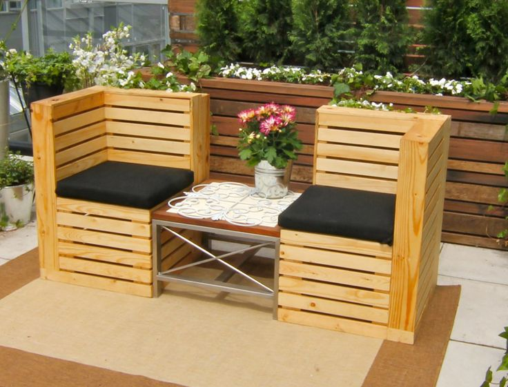 These chairs are made from wood that's been reclaimed from old skids. Designed to be a planter and an outdoor lounge.