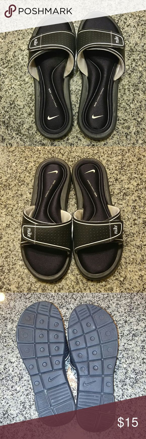 Nike Slide Sandals Black with white swoosh. Comfort footbed bounces right back into shape.  Velcro closure to adjust fit. Excellent condition. Size 8. Nike Shoes Sandals