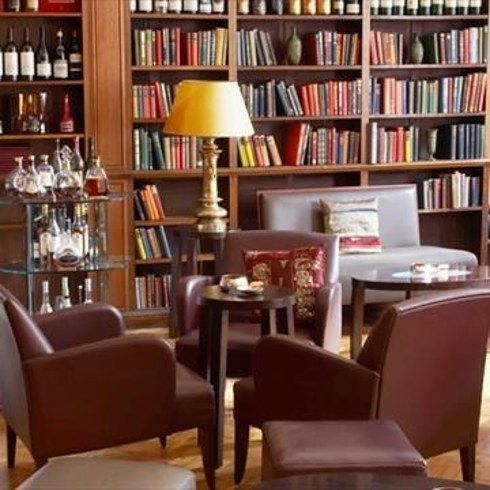 The Cinnamon Club, Westminster |   Wine and books are perfectly paired on the shelves at the Cinnamon Club's Library Bar. Once the Reading room of the old Westminster Library, the space hasn't lost its roots, and keeps the literary spirit alive with an extensive selection of books to go with your booze. 16 Incredible Library Bars In London