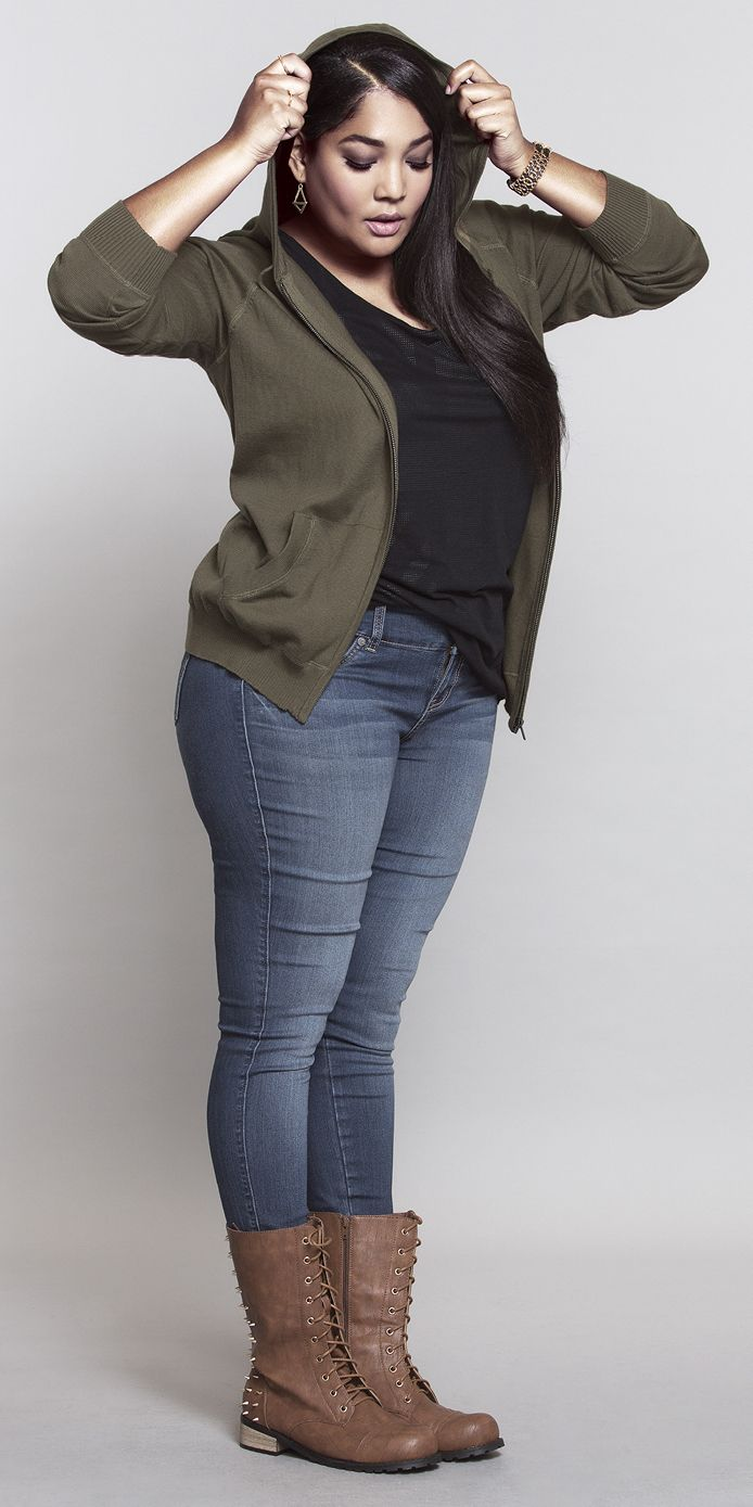 Curvy girl wearing plus size fashion. Short ankle brown boots and