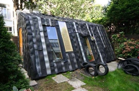 Given that tire rubber is extremely durable, waterproof and takes quite a long time to degrade, why not use it as siding and roofing for a garden shed? This unique structure does just that, using discarded rubber tires to weatherproof a small garden dwelling.