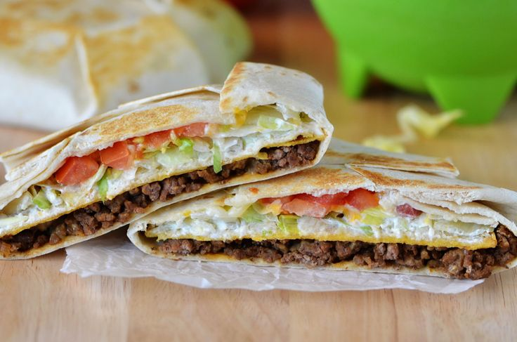 I have a small confession. I love me some Taco Bell.  We don't eat there very often, but when we do, it's these babies I order. Have you ever had one? Well let me fill you in if you haven't… Seasoned ground beef, nacho cheese, a crunchy corn tortilla, sour cream, lettuce …